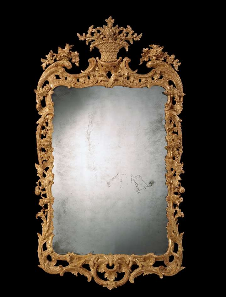 A GEORGE II CARVED GILTWOOD MIRROR